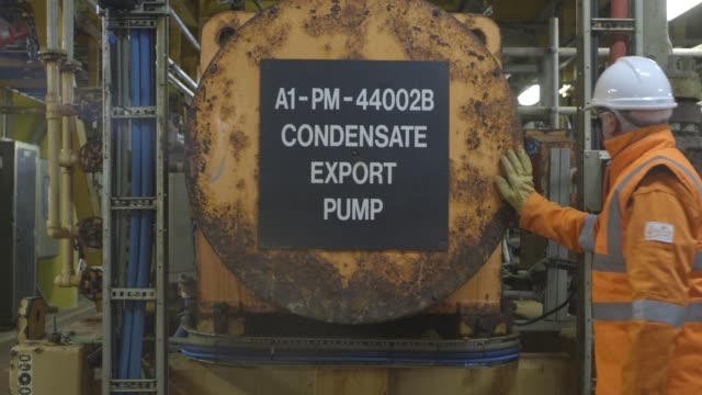 An employee uses a phone to contact the control room on the Armada gas condensate platform operated by BG Group Plc in the North Sea off the coast of...