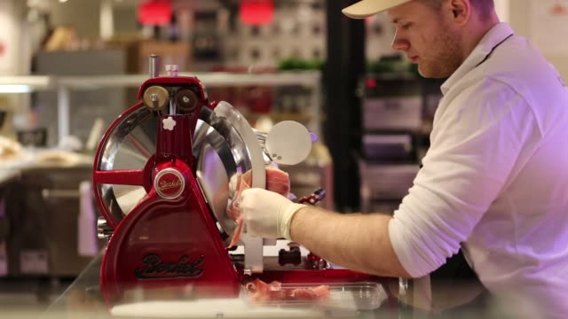an employee uses a slicing machine to cut thin slices of italian cured meat inside the new eataly food store, operated by eataly net s.r.l., at the... - cheese stock videos & royalty-free footage