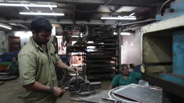 an employee uses a steel file inside an ishwar engineering co. factory in mumbai, maharashtra, india, on saturday, feb. 7, 2015 - personal hygiene product stock videos & royalty-free footage