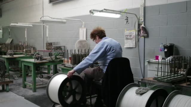an employee uses a yarn bobbin to separate lace strands inside the desseilles laces lace factory in calais france on tuesday march 8 2016 - ball of wool stock videos & royalty-free footage