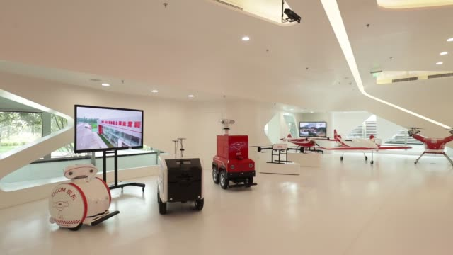 stockvideo's en b-roll-footage met an employee walks past a digital screen at a showroom inside the jd.com inc. headquarters in beijing, china, on monday, oct. 23 employees walk in... - toonzaal