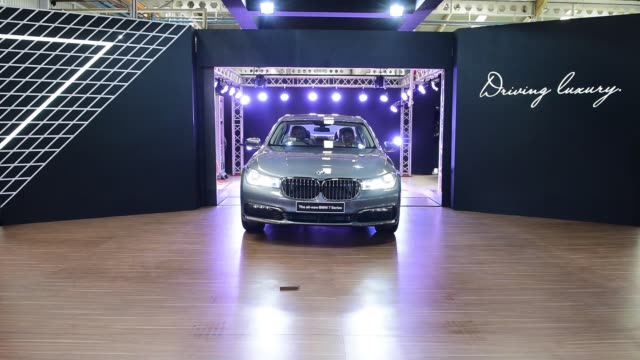 An employee walks past BMW AG 7Series sedans at the assembly line of a PT Gaya Motor factory in Jakarta Indonesia on Wednesday Nov 30 A BMW AG badge...