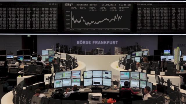 an employee walks through the frankfurt stock exchange in frankfurt germany on wednesday aug 21 stock market information is displayed on the dax... - dax stock market index stock videos and b-roll footage