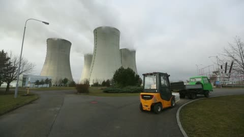 an employee walks towards dukovany power station, operated by cez as, in dukovany, czech republic, on wednesday, jan. 15 cooling towers emit vapour... - one way stock videos & royalty-free footage