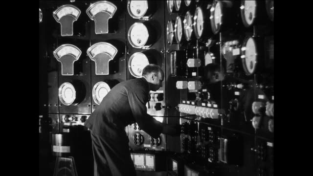montage an employee working in a power station control room sending electricity to different areas around the country / england, united kingdom - control room stock videos & royalty-free footage