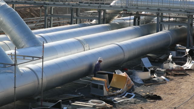 an employee works at a pipework on the european gas pipeline link radeland 2 compressor station, which accommodates downstream gas flows from the... - pipeline stock videos & royalty-free footage