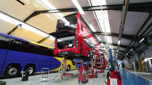 An employee works beneath the drivers cab of an Enviro 400 London bus at the Alexander Dennis Ltd factory in Scarborough UK on Wednesday Sept 13 An...