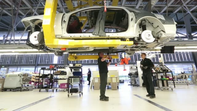 stockvideo's en b-roll-footage met an employee works on the interior wiring assembly of a wraith automobile at the rolls royce motor cars ltd production plant in goodwood uk on... - bumper
