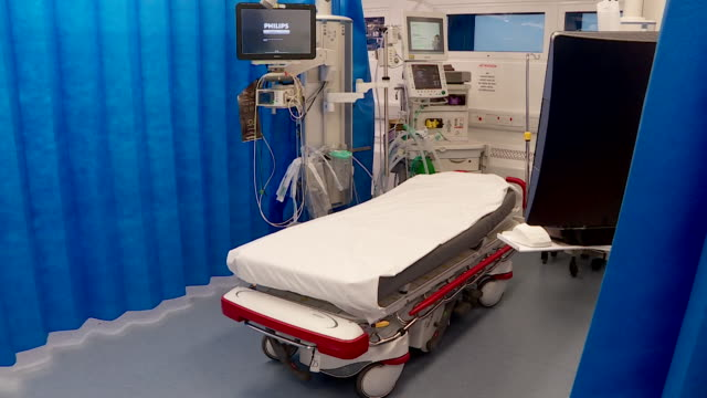 an empty accident and emergency bed stands in imperial college hospital in a curtained cubicle amid concerns that there is overcrowding of nhs... - krankenhaus rollbett stock-videos und b-roll-filmmaterial