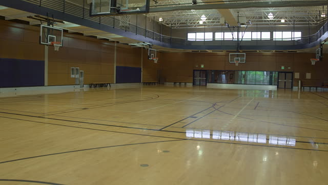 an empty basketball court during daytime - コート点の映像素材/bロール