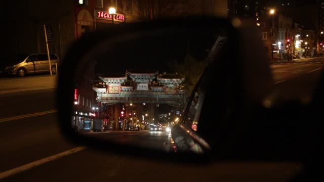 an empty chinatown is seen in a vehicle's side mirror april 1, 2020 in washington, dc. the district of columbia has joined other states and... - maryland stato video stock e b–roll