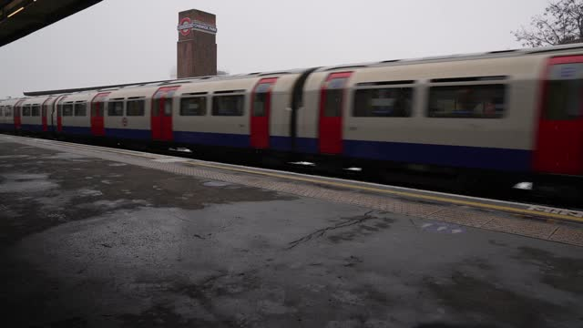 an empty chiswick park station as a piccadilly line train passes through on january 24, 2021 in london, united kingdom. parts of the country saw snow... - mode of transport stock videos & royalty-free footage