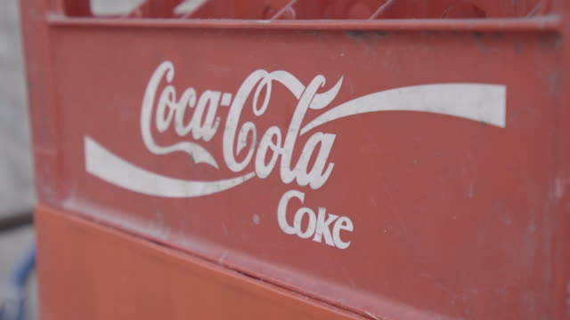 an empty coca cola crate is seen outside a shop in central warsaw, poland on september 18, 2019. - cola stock-videos und b-roll-filmmaterial