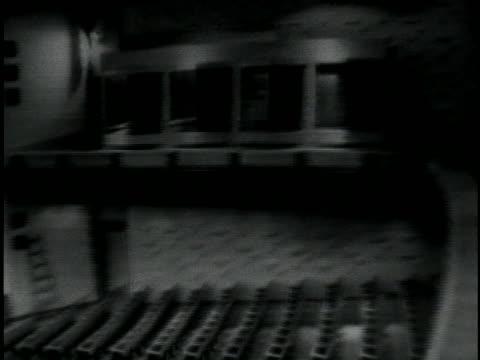 an empty courtroom stands ready for the trial of world war ii war criminal adolf eichmann. - ゲシュタポ点の映像素材/bロール