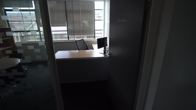 an empty desk as office space sits empty since a nationwide lockdown in march on august 17, 2020 in london, england - desk stock videos & royalty-free footage