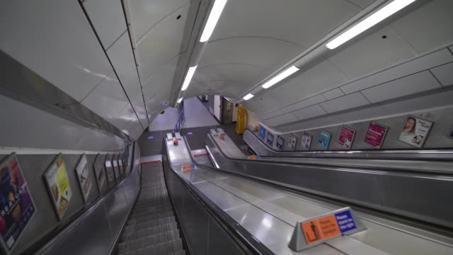 an empty escalator at victoria station during rush hour as lockdown restrictions are eased after 7 weeks on may 13 2020 in london england the prime... - time stock videos & royalty-free footage