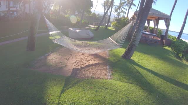 an empty hammock at beach in kaanapali, maui, hawaii. - slow motion - maui stock videos & royalty-free footage