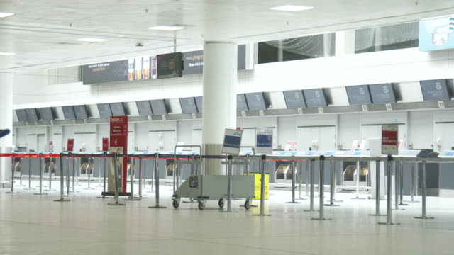 an empty jet2 check-in at glasgow airport due to coronavirus - airport stock videos & royalty-free footage