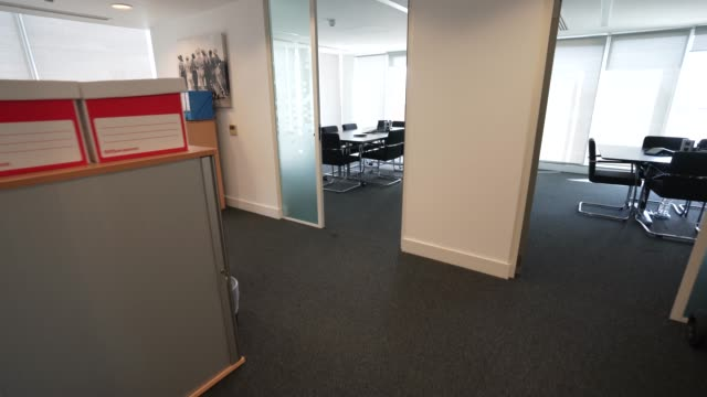 an empty meeting room as office space sits empty since a nationwide lockdown in march due to the coronavirus covid-19 pandemic on august 17, 2020 in... - employment issues stock videos & royalty-free footage