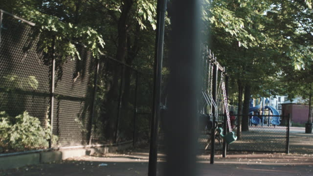 vidéos et rushes de an empty playground on a summer afternoon - aire de jeux