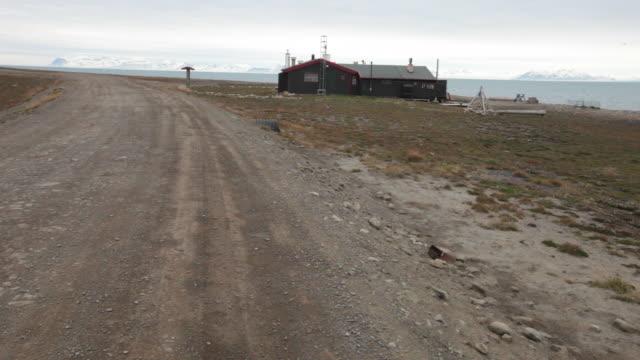 An empty road and a house at Adventfjorden near Longyearbyen, Svalbard archipelago