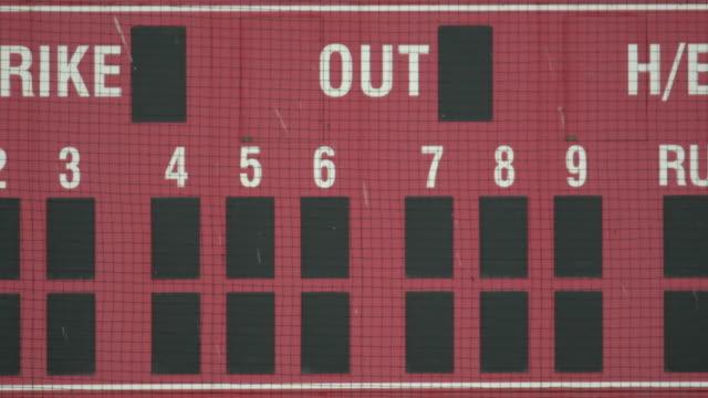 an empty scoreboard at a baseball field game. - slow motion - scoreboard stock videos & royalty-free footage