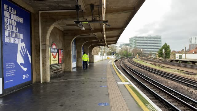 an empty train platform at chiswick park station during what would be traditional peak time as a cleaner disinfects the station on january 11, 2021... - land vehicle stock videos & royalty-free footage