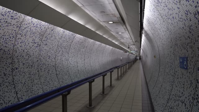 an empty walkway at green park station as key workers are only allowed to use the london underground network du the the the coronavirus pandemic on... - permission concept stock videos & royalty-free footage