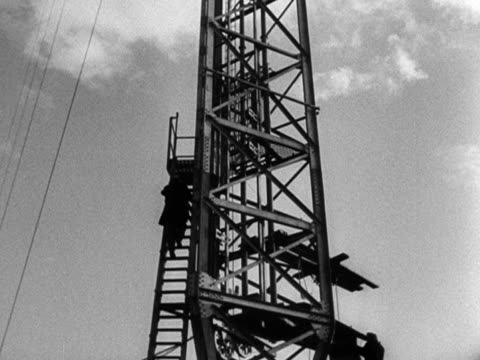 an engineer climbs up the new television transmitter at sutton coldfied - 1949 stock videos and b-roll footage