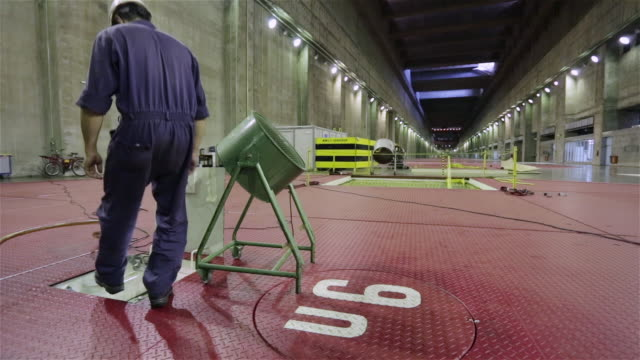 'WS, PAN An engineer enters the central section of a generator unit in Itaipu Binacional Dam / Foz do Iguacu, Brazil'