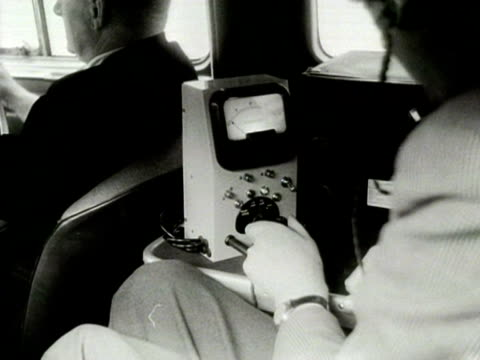 an engineer inside a television detector van uses a piece of monitoring equipment 1954 - van stock videos & royalty-free footage
