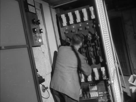 vídeos y material grabado en eventos de stock de an engineer pulls switches on a large fuse board at the new children's television studio at bbc lime grove - bbc