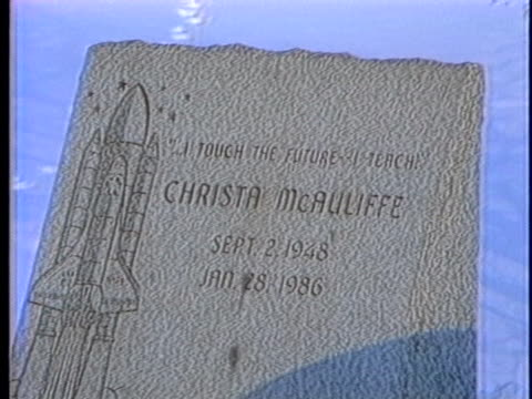 an engraved head stone stands in the snowy calgary cemetery in memory of challenger astronaut christa mcauliffe, killed in the space shuttle... - (war or terrorism or election or government or illness or news event or speech or politics or politician or conflict or military or extreme weather or business or economy) and not usa stock videos & royalty-free footage