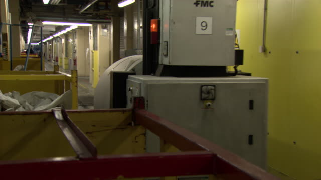 an enormous roll of paper is transported by an automated vehicle at a newspaper printing press, uk. - editorial stock videos & royalty-free footage