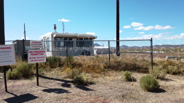 an entrance gate to the nevada test and training range, located near area 51, on september 20, 2019 near rachel, nevada. people have gathered at the... - nevada stock-videos und b-roll-filmmaterial