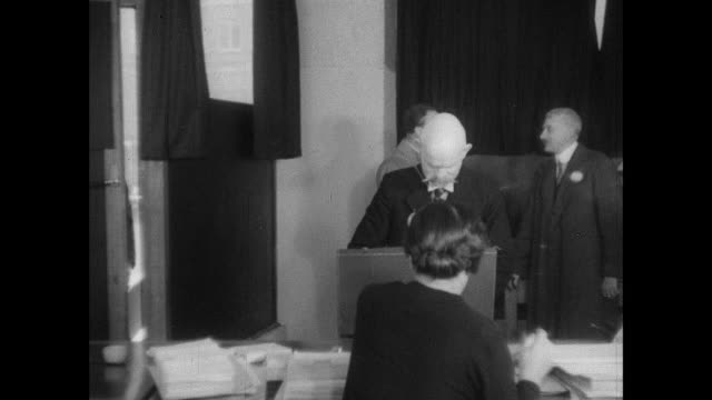 montage an enumerator returns to the national registration office and submits the completed registration forms / united kingdom - 国勢調査点の映像素材/bロール