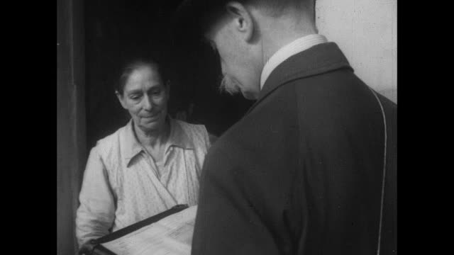 MONTAGE An enumerator reviews citizen's registration form and then she receives the household identity card / United Kingdom