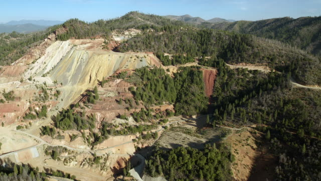 an eroded mountainside called slickrock slide, part of the abandoned iron mountain mine site, an area undergoing decontamination for acid-mine-drainage. - copper mine stock videos and b-roll footage