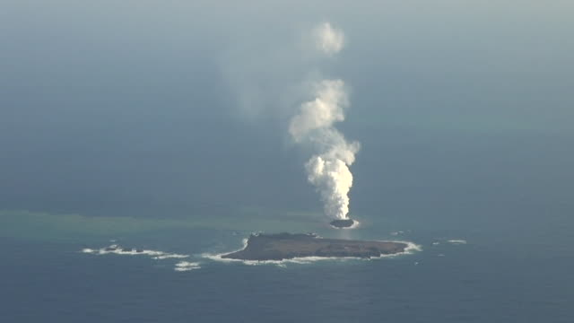 aerial, an eruption created a new, small island in ogasawara, japan - entstehung stock-videos und b-roll-filmmaterial