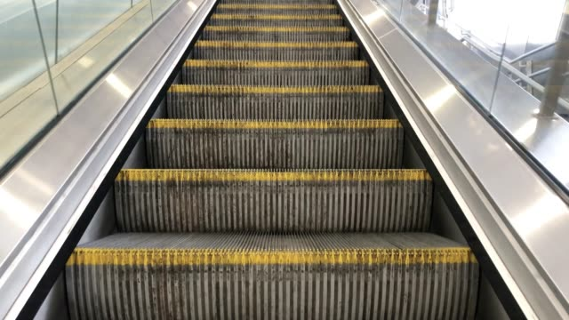 an escalator at a train station going up - steps and staircases stock videos & royalty-free footage