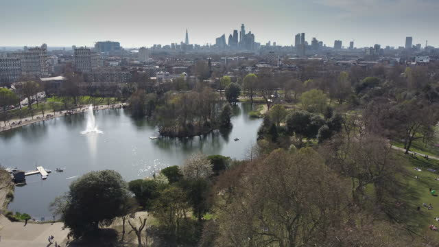 an establisher shot over the fountain and lake in victoria park east london - establishing shot stock videos & royalty-free footage