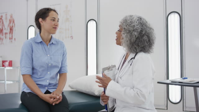 an ethnic doctor meets with her patient - asking stock videos & royalty-free footage