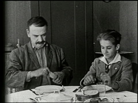 an evening at home: a film lesson in citizenship - 4 of 9 - anno 1921 video stock e b–roll