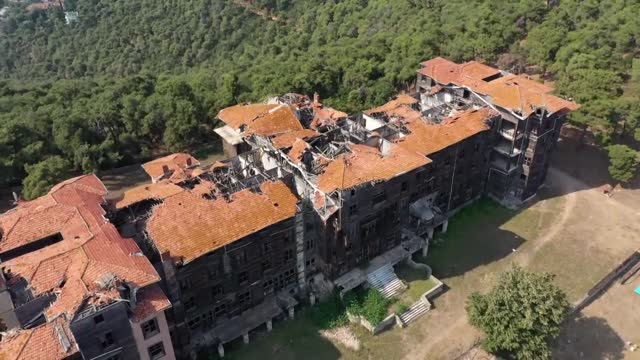 an event at istanbul's historic buyukada greek orthodox orphanage, which has been closed since 1964, called for cooperation to launch a massive... - dissolving stock videos & royalty-free footage