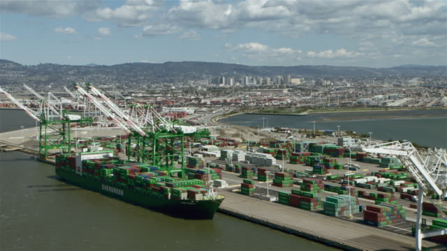 oakland, california - april 6, 2012: an evergreen cargo ship loaded with intermodal shipping containers is docked at the oakland outer harbor in the port of oakland. - evergreen stock videos and b-roll footage