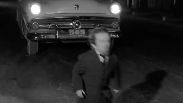 vídeos y material grabado en eventos de stock de an evil toy gets hit by a car when crossing the street - enano