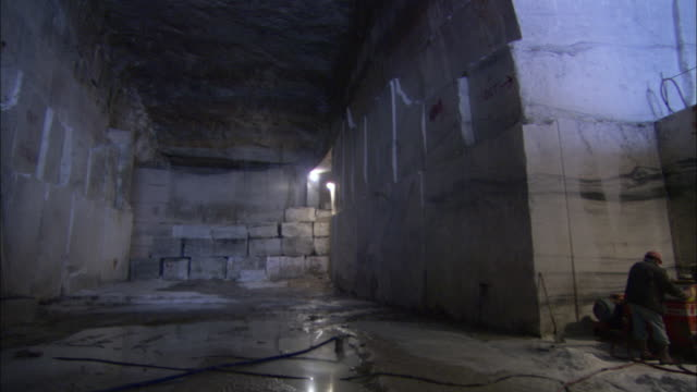 an excavator cuts blocks of granite. - granite stock videos & royalty-free footage