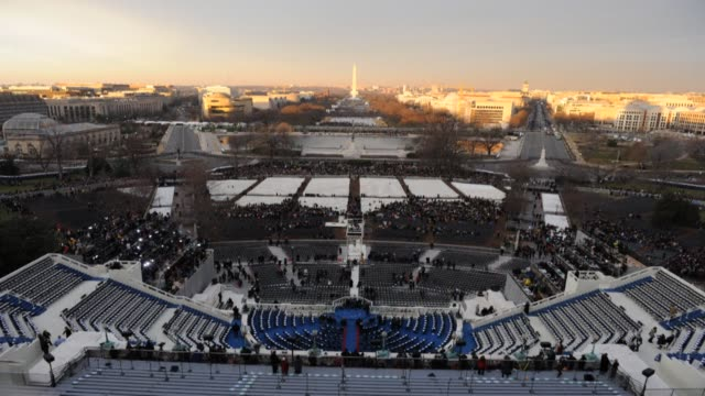 an excited crowd of about one million people filled up washington national mall monday for barack obama second inauguration as us president anchored... - anchored stock videos & royalty-free footage
