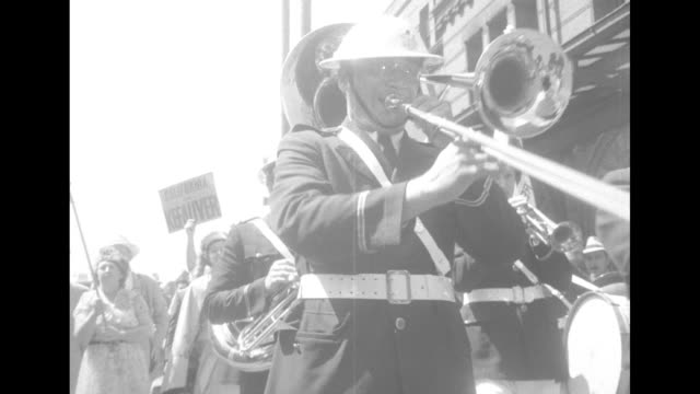 vs an excited group of people carrying campaign posters for alben barkley and estes kefauver group together and a brass band plays behind delegates... - alben w. barkley stock videos and b-roll footage