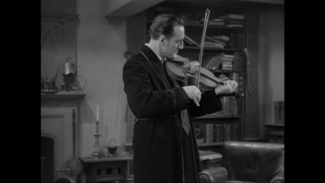 1946 an excited sherlock holmes (basil rathbone) works out code with help of surprised doctor watson (nigel bruce) - sherlock holmes stock videos & royalty-free footage
